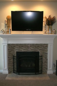 Gorgeous mosaic tile fireplace with white mantle. i could do this to the fireplace in our front room! Tv Over Fireplace, Fireplace Redo, Fireplace Remodel, Fireplace Design, Fireplace Ideas, Fireplace Seating, Fireplace Shelves, Mantle Ideas, Fireplace Mirror