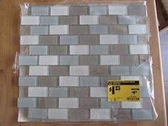 Buy a tile mosaic (lowes/home depot). They cost from 1 dollar, with over 60 mosaic tiles per square. Pop off the individual tiles, label and glue. Would look great for toy storage boxes, baskets, square canisters for flour/sugar. Too cute!