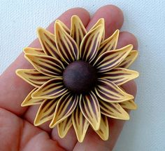 #10 by ZudaGay Pease, via Flickr. This Polymer Clay sunflower is so nice!