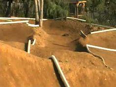 Fast action and jumps at the rc car track!  Neat remote control car video.