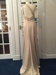 Champagne satin one shoulder with cut out back and train.