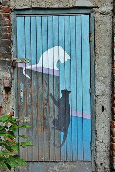Door in the Praga district, Warsaw, Poland - photo by nihilnocet, via Flickr