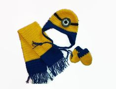 Baby Minion Hat, Scarf and Mitten Set  Every little girl or boy, wants to be a minion. This little set includes the hat, scarf, and mittens. Soft and warm, and great for those winter chilly days. This cute little outfit is the perfect set for going out in, for pictures, and best of all showing off your new little bundle. Sizes Newborn, or 0-3 Months,