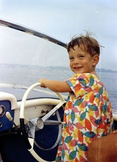 Weekend at Hyannis Port: John F. Kennedy, Jr., at the wheel of a speedboat 1963 August 25