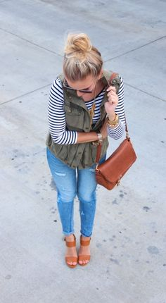 Stripes, ripped jeans and army green utility vest. @jailynnroche