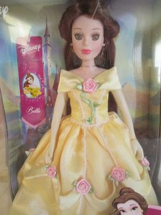 It is Belle in her gorgeous yellow dress from Beauty and The Beast. This doll comes with a porcelain keepsake box with the all important rose on top. Design: Belle's hair is very long, she is wearing the dress from the Beauty and The Beast dance scene.   eBay!