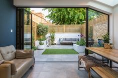 Airy, light filled spaces are considered the pinnacle of modern living and this project is a fine example. A set of bi-folding doors and a fixed glass panel provide a . Garden Room, Small Garden Design, Patio Spaces, Open Plan Kitchen Living Room, Exterior Design, Bifold Doors Onto Patio, House Extension Design, Small Courtyards, Back Garden Design