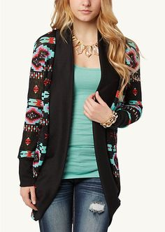 Tribal print cardigan, teal tank, beige necklace and ripped skinny jeans.