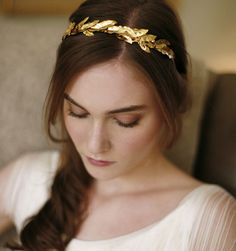 EOS HEADBAND A remarkably easy-to-wear crown of petite metal leaves that are handcrafted to curve around a comfy gold ribbon-wrapped headband. This gold headpiece works well with both formal and casual attire, it is the perfect hair accessory for pairing with a gown for an evening out or button down blouse for the office. Works well with gold jewelry. Handmade in New York City. $298.00