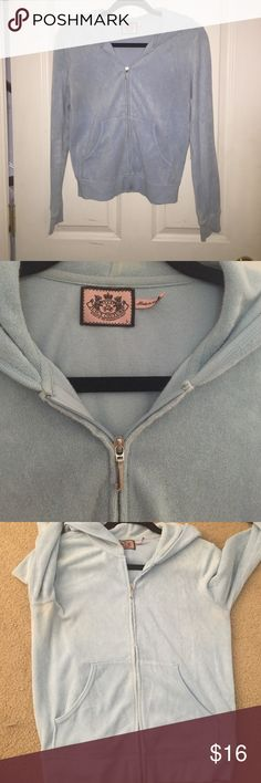 Juicy Couture Baby Blue Zip Up Juicy couture baby blue zip up hoodie! Princess juicy graphic design on the lower back of the hoodie! Hoodie in okay condition, worn under arms, a couple small discolorations/stains! Juicy Couture Tops Sweatshirts & Hoodies