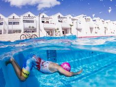 "Petra Van Borm, Belgium, Entry, Open, Split Second, 2016 Sony World Photography Awards ""A young boy training hard in the pool to participate in the yearly triatlon while other kids are playing. The image is taken at Sandsbeach resort pool in Lanzarote."""