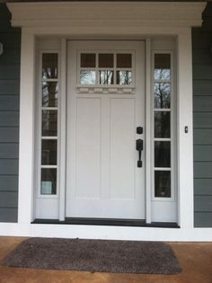 Crisp and clean just in time for spring.  Clopay Craftsman Collection fiberglass front door factory-painted in white with Clarion windows, sidelights and options dentil shelf molding. www.clopay.com