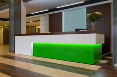 This neon hotel reception desk makes for an eye-catching entrance - and makes the check-in area easy to find for guests. Part of a hotel refurbishment project.