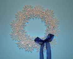 This DIY Delicate Snowflake Wreath is the perfect DIY winter wreath because it is festive and cheerful enough to work during Christmastime and it is holiday-neutral enough to leave up all winter.