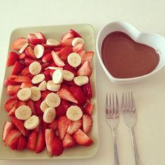sliced bananas, strawberries and chocolate for dipping! I love the heart dish though for the chocolate ;) Xx