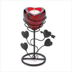 A deep red candle cup and twining heart vine base turn this clever candle stand into the image of pure romance! An amorous decoration that transforms any evening into a night to cherish forever. Candle not included. Red Candles, Tea Light Candles, Tea Lights, Candle Lighting, Candle Stand, Tealight Candle Holders, Rose Candle, Glass Candle, Candle Wedding Centerpieces