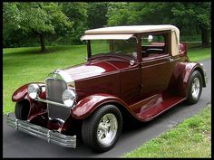 1928 Buick Master. This beautiful Street Rod in a dark garnett glass paint comes with the following features: - Frame-off restored - Steel body, fenders and.