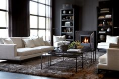 Dark walls, dark floors, fireplace, furniture
