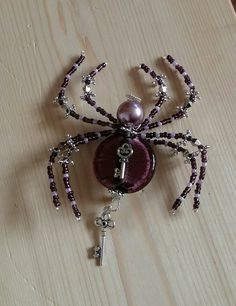 I wish I had more of the gorgeous focal bead I used for this handmade beaded spider brooch ...which has now Sold!