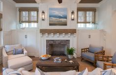 The designer was inspired by coastal colors from the painting to furnish the rooms, relying on whites and blues.