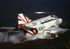 """F-4N Phantom II aircraft of Fighter Squadron (VF) 111, the """"Sundowners,"""" launching from the carrier Franklin D. Roosevelt (CV 42) operating in the Mediterranean Sea. This marked the final cruise for the carrier, the first named for a President of the United States. She decommissioned on September 30, 1977. This photo was taken 40 years ago this month in February 1977."""