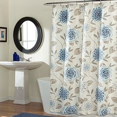 Featuring a lovely floral print, the Jessica Shower Curtain brings the beauty of nature into any bathroom. This delightful curtain features a light ivory ground with lovely variegated shades of blueberry and sand. Machine washable and easy to care for.
