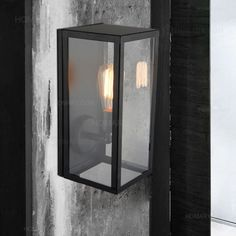 The compact dimensions make this light practical and unobtrusive. This wall lantern is inspired by the look of antique gas light. Matte black finish outer square frame with inlaid clear glass pieces h