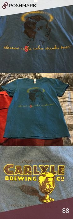 Local Carlyle brewing co t-shirt Woman with halo reads blessed is she who drinks beer, runs smaller than large tag reads. I'd say it's more like a small-medium because I usually wear med and it's small on me. Very cute and fun! Nice teal like blue Tops Tees - Short Sleeve