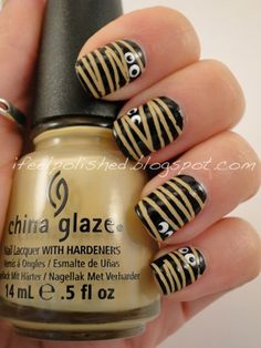 Mummy nail art, with striping tape, & eyes.  Super cute!!!