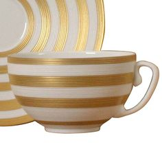 Jean-Louis Coquet's bold Hemisphere pattern teacup, Gold and white stripe teacup. Modern porcelain tea cup.