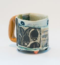 "Susan Feagin ""Sunday Newspaper Mug with Orange Handle"" by Green Hill Center for NC Art, via Flickr"