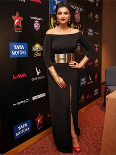 Parineeti Chopra looks sophisticated in this black dress teamed up with a golden belt. Although she looks a lil plum, one cannot deny the fact that she looks classy and that slit is just perfect.