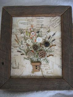 Antique buttons in a rustic wooden frame.   From:  etsy.com