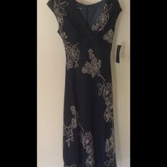 Jones New York. New With Tags size 4 **REDUCED** 100% Rayon. NWT, Msrp $148.00. Black with tan design Jones New York Dresses