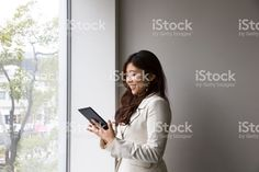 Woman Is Watching Tablet With Smile