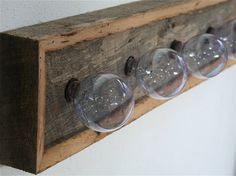 reclaimed barn wood vanity light. great re-use of those old ugly brass fixtures!