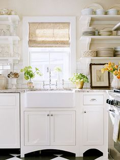 farmhouse sink, cute kitchen, cream walls white cabinets