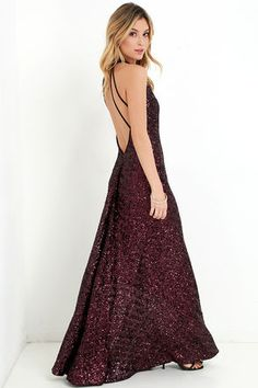 """Imagine the excitement of getting to take the Dress the Population Veronica Black and Red Sequin Maxi Dress out of your closet for an evening of pure glam! We're in awe of this gorgeous sequin dress with shades of red and purple that give it a lovely berry hue. Rounded, woven neckline fastens at back with two buttons above an open back with strappy detailing, and a sweeping maxi skirt below. Hidden back zipper. Fully lined. Dress measures 3.5"""" longer at back. Self: 90% Polyester, 10% Lycra…"""