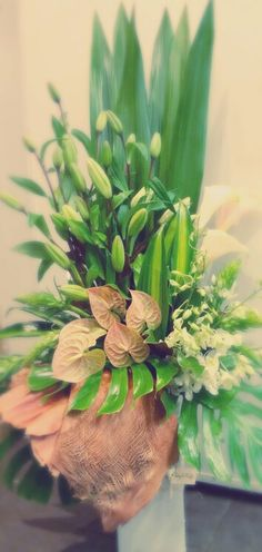 Tall corporate vase flower arrangement - lillies, arums, orchids and antheriums