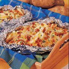 Grilled Three-Cheese Potatoes Recipe _ YES, for those men who want to cook outside and make us go inside. Move your steaks over, I got a side dish from Potato and Cheese Heaven. I Love Food, Good Food, Yummy Food, Potato Dishes, Potato Recipes, Grilling Recipes, Cooking Recipes, Cooking Tips, Great Recipes