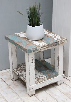 This handmade and reclaimed pine coffee table makes a lovely rustic feature for the home. Has a beautifully textured pine surface with visible grains, knots and burs. The table surface has been painted with soft blue and cream to create a rustic look. The table legs have again been painted in white to form a distressed look.