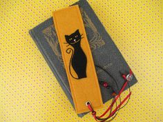 Halloween Felt Bookmark with Black Cat Motif, Ribbons, and Beads. $8.00, via Etsy -shop: ExinaArt.