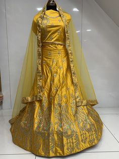 This beautiful silk lehenga choli is specially made for Diwali. The color is guaranteed to make you look gorgeous. The beautiful peacock style distributed stone embroidery enhances it's appearance.  It can be stitched in all sizes small medium large and extra large. Minimum 28 inches to maximum 44 inches chest size. Yellow Lehenga, Silk Lehenga, Looking Gorgeous, Beautiful, Diwali, Peacock, Raincoat, Embroidery, Stone