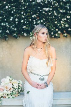 You can't help but dream of wandering the hidden paths, basking on the sun-warmed stone terrace and reveling in the cool of the lawn beneath your feet with this bohemian wedding inspiration! We love how this shoot captures the essence of a summer celebration, with fragrant blooms, light-catching lace wedding dresses and accessories from subtle to statement.       Location: WA | Photographer: Peggy Saas | Venue: Cottesloe Civic Centre | Gowns: Rue De Seine (Look 1) & Kite and Butterfly (Look…