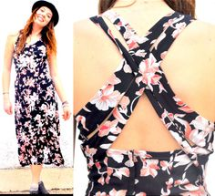This floral vintage sundress is absolutely beautiful! It is a vintage CDC petites original. The cross straps in the back reveal just enough skin to add some allure while staying classy. The pattern is black and pink floral. It has a v-neck in front and is fitted at the top and flowy at the bottom. It is perfect for a sunny summer day! If you like this lovely dress && want to view more items like it please visit my shop http://www.etsy.com/shop/shopzebra