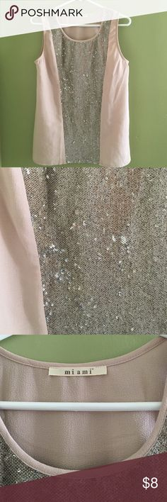 Sleeveless sequin top from Francesca's 100% polyester. Only worn twice. Perfect to transition your day outfit to night because of the sequin. This top is in a muted pale pink color. Francesca's Collections Tops Blouses