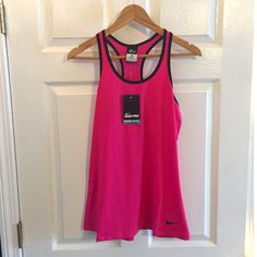 Nike Racerback Tank Pink Nike racerback workout tank. Dri-fit material and mesh back. Super cute and great for the gym! No trades please!  let me know if you have questions ❓ and make me an offer!!  happy shopping!   All items from a smoke free home! Nike Tops Tank Tops