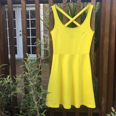 """H&M Yellow Dress Pretty H&M spring dress. 15"""" between under arms. 26"""" waist. 35"""" shoulder to hem.  Light weight. Good condition. Perfect for spring and summer.  ••••Firm Price unless purchased with bundle•••• H&M Dresses Mini"""