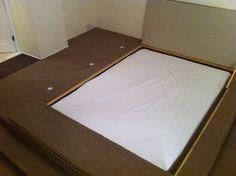 Bed hidden in raised flooring. Plus storage in floor and steps.