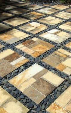 a possible pattern to do in the bbq / table seating area? where the black stone would be gravel and the paver would be the large squares... or vice versa??